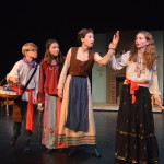 Hansel and Gretel's mother try to sell her ring to the gypsies for food to eat. (From left to right: Oliver Meek, Isabel Dines, Izabella Porter and Avery O'Kane.)