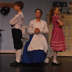 Mary Poppins (Kaely Clapper) teaches Michael Banks (Aidan Pritchard) and Jane Banks (Brenna Kay) that in every job that must be done there is an element of fun.
