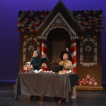 Frick (Grace Gent)  and the Gingerbread Witch (Jessica Layton)  prepare gingerbread cookies.