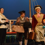 From left to right: Captain Smollett (Annie Wood), Dr. Livesey (Liam Clancy) and Squire Trelawney (Brian Metcalf) board the ship to Treasure Island