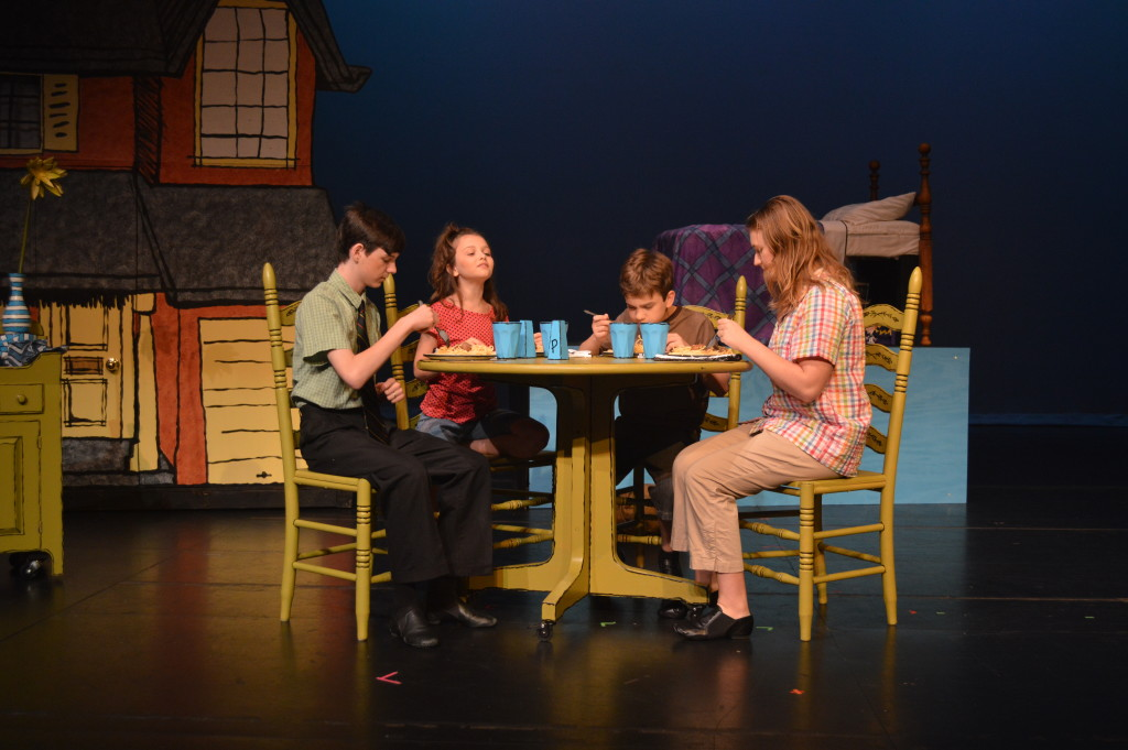 From left to right: Mr. Otterloop (Henry Hubbard), Alice (Gabriella Flanagan), Petey (Xander Tilock), and Mrs. Otterloop (Caitlyn Knittig).