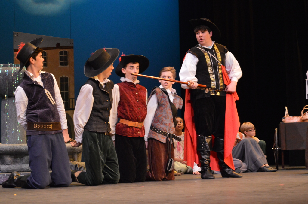 The musketeers are caught in the hands of Captain Rochefort (Angus Long). Will they escape? Find out at Encore's production of The Three Musketeers.  From left to right: Aramis (Brody Karton), Porthos (Colin Meek), Athos (Zach Longsworth) and D'Artagnan (Christopher Wagner). Photo by Aileen Pangan