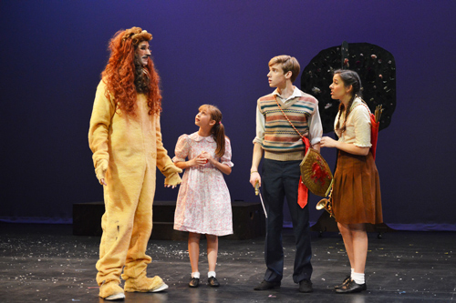From left to right: Aslan (Sean Hackes), Lucy Pevensie (Isabel Tate),  Peter Pevensie (Richard Bew) and Susan Pevensie (Lauren Monsivaiz).